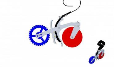Un disque à l'avant (en rouge) coupe le végétal. A l'arrière, la roue dentée tasse la graine et crée une butée pour recouvrir la graine. (illustration Carbure Technologies)